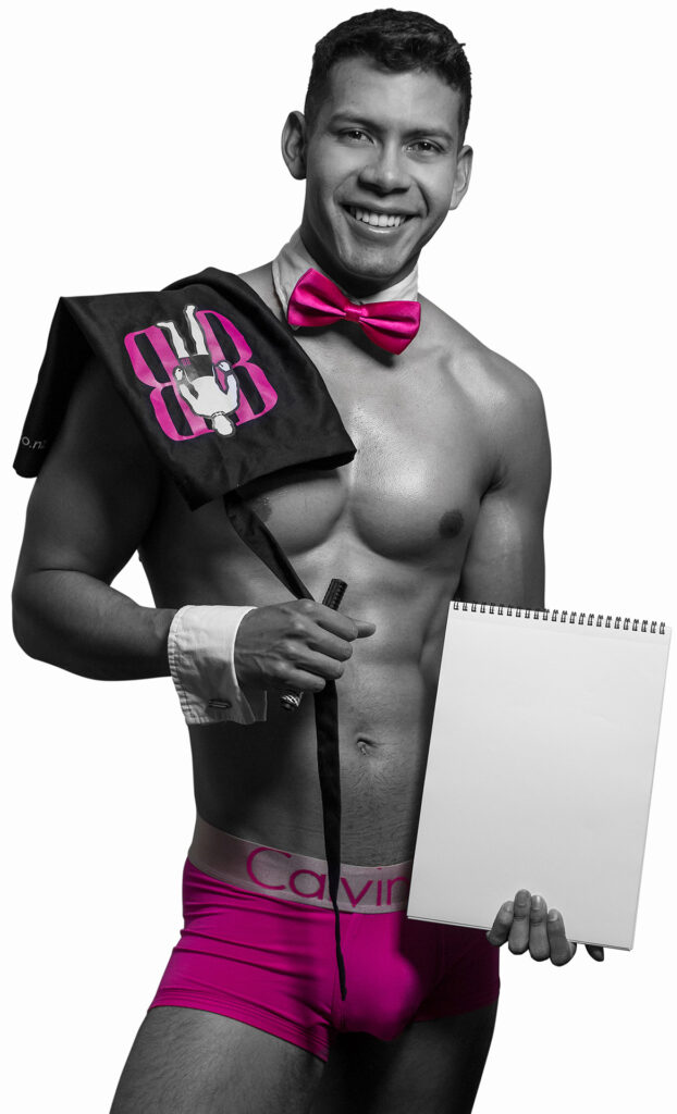 Muscular man poses with drawing materials